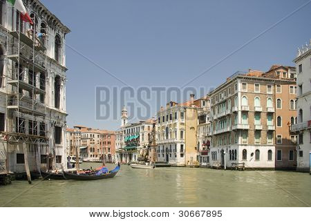 Boats at venetian canal among old and multicolored houses in (Grand canal, Venice, Italy)
