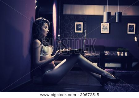 Sexy woman browsing internet late night
