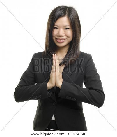 Asian woman in a traditional wellcoming gesture