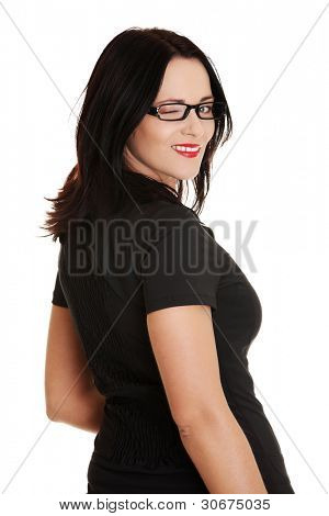 Beautiful caucasian woman winks, isolated on white background