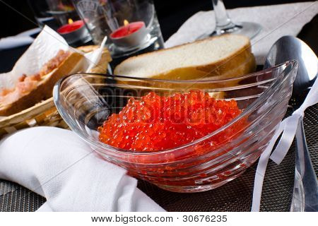 Red caviar in a glass plate