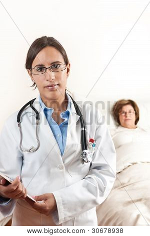 Doctor With Senior Patient In Background