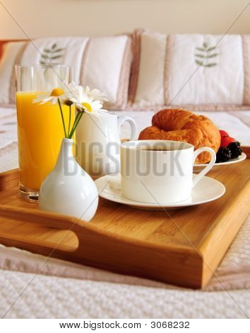 Breakfast On Bed In A Hotel Room