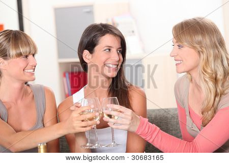 Three housemates drinking wine together