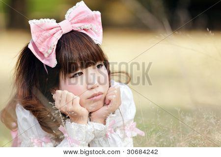 japanese woman in sweet lying in meadow, tokyo
