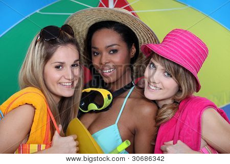 Three female friends at the beach.
