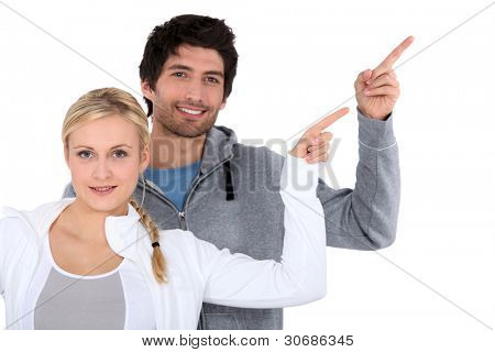 man and woman pointing with finger