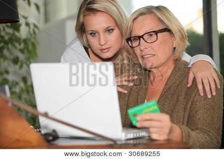 Older woman using a card online