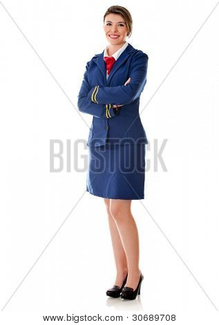 Flight attendant standing wit arms crossed - isolated over a white background