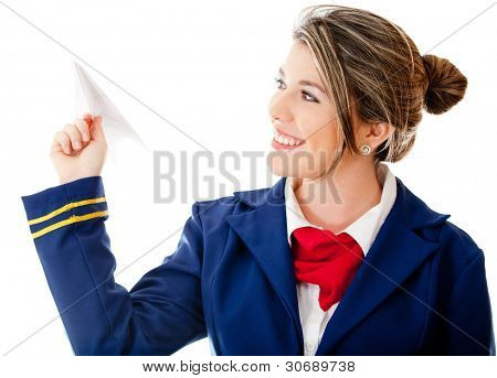 Stewardess holding a paper airplane - isolated over a white background