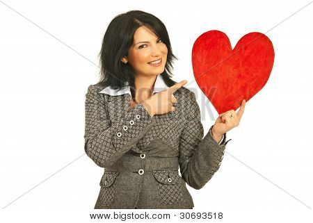 Happy Woman Pointing To Heart Shape