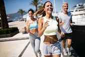 Running, Friends, Sport, Exercising And Healthy Lifestyle Concept. Happy People Jogging Outdoor. poster