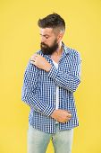 Perfectly Imperfect. Fashion Man Dusting Specks Off His Sleeve On Yellow Background. Bearded Man In  poster