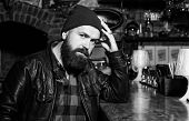 Brutal Hipster Bearded Man Sit At Bar Counter. Friday Evening. Hipster Relaxing At Bar. Bar Is Relax poster