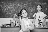 Smart Children Performing Chemistry Test. Small Pupil Learning Chemistry In School. Chemistry Labora poster