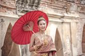 Traditional Thai Dress. Beautiful Women Wearing A Traditional Thai Cloth As A Wedding Dress Holding  poster