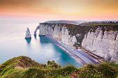 coastal landscape along the Falaise dAval the famous white cliffs of Etretat village with the Porte poster