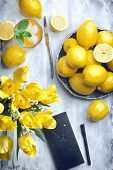 Bright Flatlay Food Background - Empty Wooden Board With Lots Of Lemons, Glass Of Lemon Juice, Yello poster