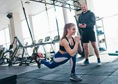 Training Under The Supervision Of A Personal Trainer. Functional Training. Woman Doing Exercise With poster