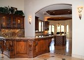 image of corbel  - lovely kitchen with nice bar with granite countertop and cabinets of alder wood - JPG