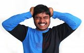 pic of nervous breakdown  - Young stressed indian pulling his hair apart and showing his frustration - JPG