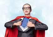 Portrait Of Business Woman Super Heroine. Attractive Young Business Lady In Suit With Red Cloak On B poster