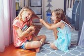 Two Little Mad Angry Girls Sisters Having Fight At Home. Friends Girls Can Not Share Toy Bag. Lifest poster