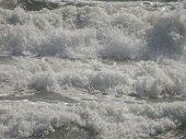 Background. Raging Sea Waves With Foam And Splashes. White And Gray Cool Tones. poster