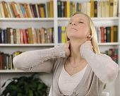 stock photo of stiff  - Portrait of young woman suffering from severe neck pain - JPG