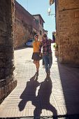 Couple on travel - Happy young couple on travel vacation in Europe. Happy women and men in love trav poster