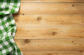 cloth napkin at rustic wooden plank board table background, top view poster