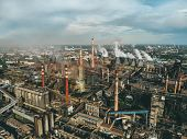Aerial View Of Factory Or Plant Industrial Area With Many Pipes Or Chimneys With Smoke. Heavy Indust poster