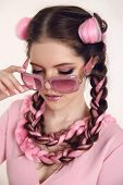 Brunette Teen Girl Braided With Two French Braids From Pink Kanekalon In A Beauty Salon. Professiona poster
