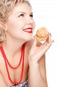 foto of plus size model  - isolated portrait of beautiful smiling young blonde size plus woman model with tasty cream tart in hand - JPG