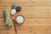Bath salts natural spa products top view on bamboo wooden texture background with copy space for wel poster