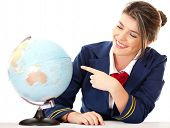 picture of air hostess  - Air hostess pointing at the globe  - JPG