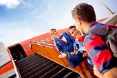 stock photo of air hostess  - Passenger going into the airplane and air hostesses welcoming him - JPG