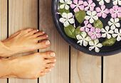 Spa Treatment And Product For Woman Feet And Foot Spa. Foot Bath In Bowl With Tropical Flowers, Thai poster