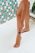 Beauty Woman Legs.young Woman Shaving Her Legs In The Bath. Wet Feet, Women Legs In The Shower. Girl poster