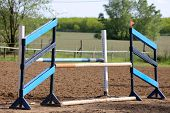 Image Of Show Jumping Poles On The Training Field. Wooden Barriers For Jumping Horses As A Backgroun poster
