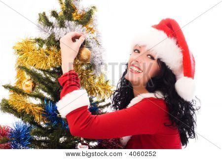 Beautiful Brunette Woman Decorating A Christmas Tree