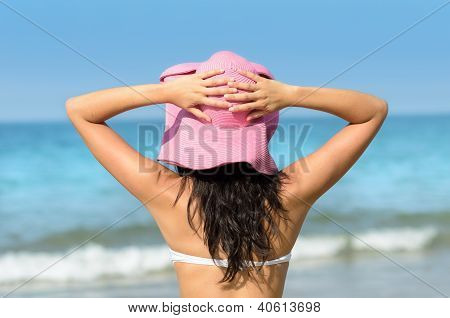Woman With Pink Sun Hat In Summer Towards The Sea