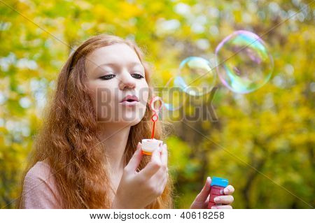 Young Redhead Girl Blowing Bubbles