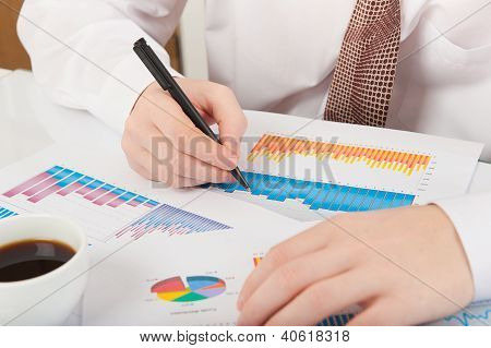 Businessman Analyzing Graphs