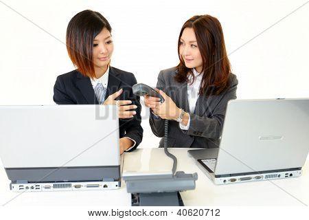 Asian businesswomen smiling