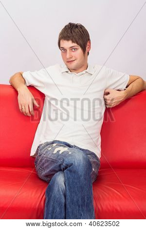 White Man Sitting On A Red Couch