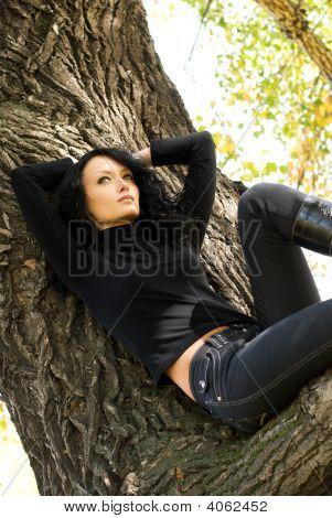 Beautiful Sad Girl On The Tree