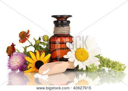 medicine bottle with tablets and flowers isolated on white