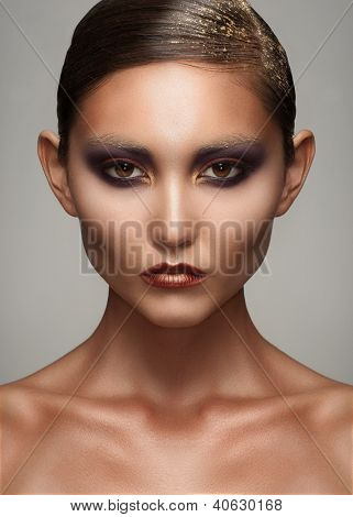 Portrait of attractive young woman with creative bright makeup