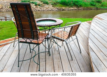 Chairs And Table Near The River